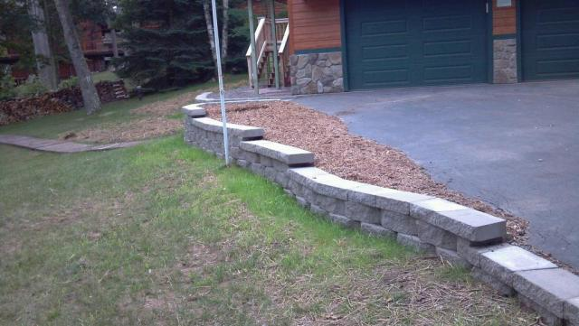 Retaining Wall With Creative Mulch Bed on Top